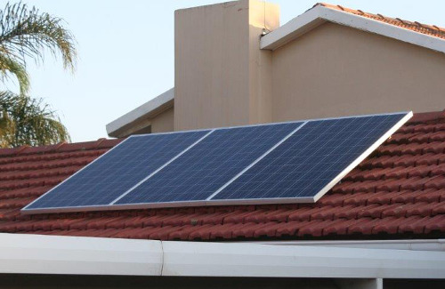 3 photovoltaic panels on tiled roof