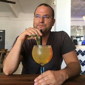 Barry Varkel sipping cocktails