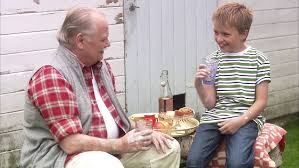 Grandfather and grandson eating