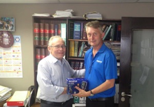 Tony Ellis receiving the Olympus DS-5500 from Olympus's sales manager Shaun Naude