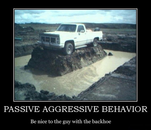 backhoe demotivational poster