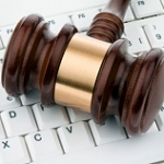 gavel on-computer-keyboard
