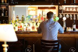 Guy sitting at the bar before jumping out the window
